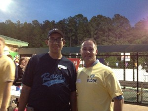 Brian Grubbs and Mike Alberico volunteering at the Miracle League of the Triangle. The Miracle League's mission is to create positive life experiences for children and adults with special needs and for their families through baseball.